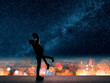canvas print picture - man hold his girlfriend up above the city