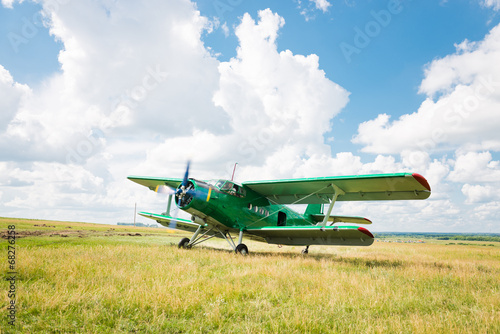 old airplane on green grass Canvas Print