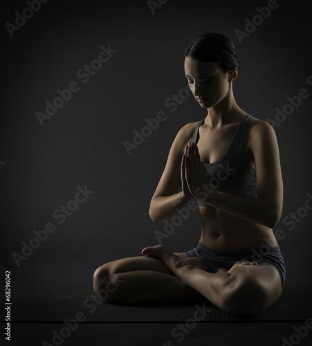 Yoga woman meditate sitting in lotus pose. Silhouette exercise