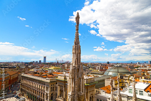 A statue of the Dome of Milan cathedral with the city view Poster