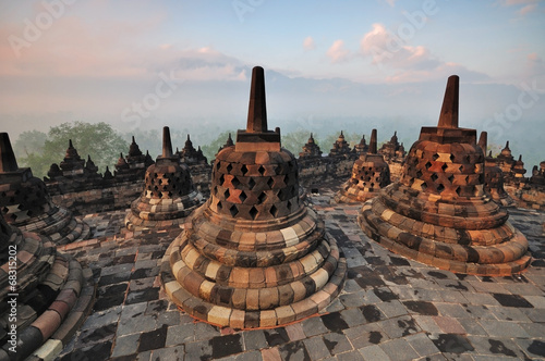 Sunrise at Borobudur Temple Stupa Jogjakarta, Indonesia.
