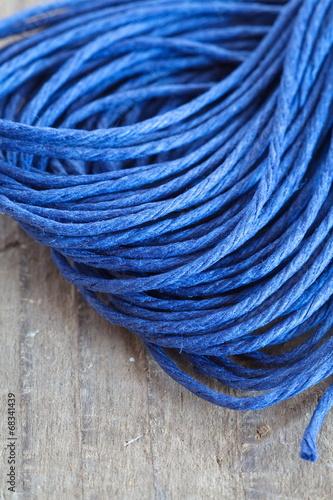 Tuinposter Schip Close - up blue hemp ropes on wooden background
