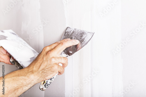 Fotografia, Obraz  A man working with spatula