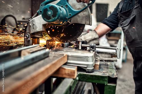 Fotografie, Obraz  man, worker using a sliding compound mitre saw with blade