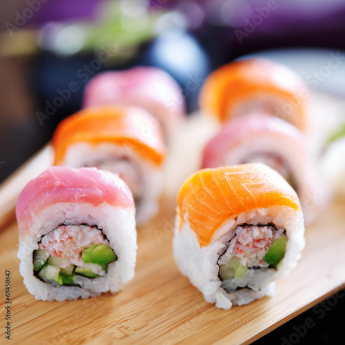salmon and tuna sushi on a wooden tray Canvas Print