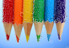 Colorful Pencils In Water With...