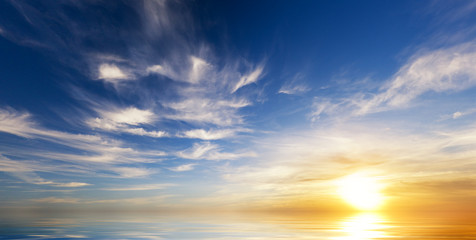 Fototapeta Sky background on sunset.