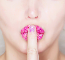 Finger On Glossy Pink Lips