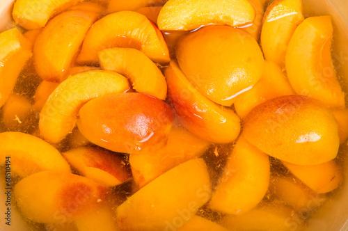 Fotografie, Obraz  Bowl of fresh sliced peaches in syrup