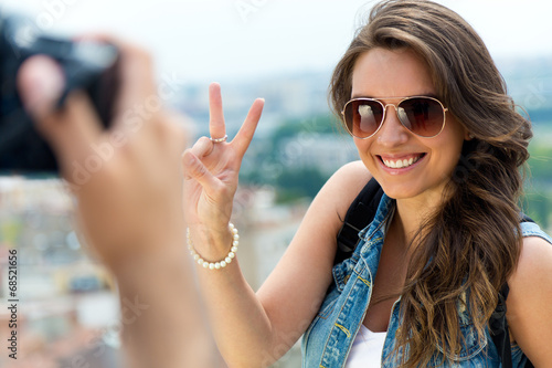 Young men taking photo of his girlfriend.