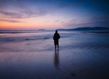 Person On The Beach At Twilight