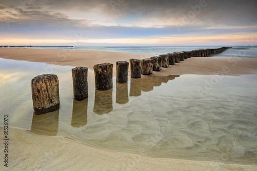 Fototapeta Wschód słońca na plaży obraz