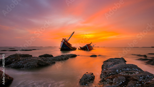 Garden Poster Shipwreck Fishing boat beached with sunset view
