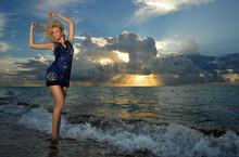 Model Posing In Beach Dress At Early Morning Sunrise