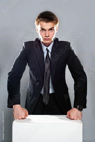 Photo  Young and seriously businessman