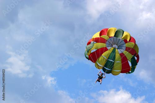 Fotografie, Obraz  Parasailing against cloudy sky