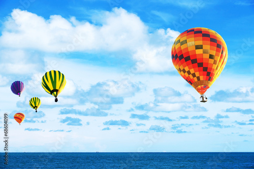 Poster Balloon Colorful hot air balloon fly over the blue sea