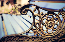 Detail Of Old Park Bench With Ornaments, Bokeh Background