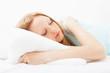 girl in nightshirt sleeping in bed