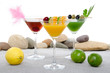 Orange, cherry and cucumber cocktails in a environment of sand a
