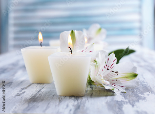 Fototapety, obrazy: Beautiful candles with flowers on wooden background