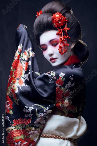 Obraz na plátne young pretty geisha in kimono