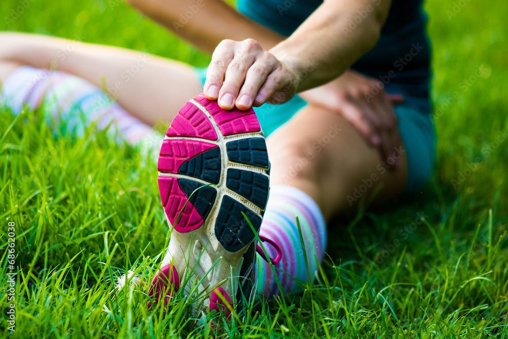 Fototapety, obrazy: fitt girl getting streching her legs before running outdoors