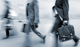 motion blurred business people walking on the street - 68670670