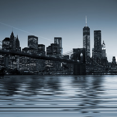 Panel Szklany Panoramic view New York City Manhattan downtown skyline at night
