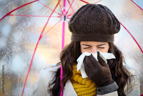 Fotografia, Obraz  Woman coughing and blowing her nose in autumn