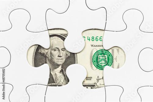 Fotografía  US dollar banknote hidden under puzzle financial concept