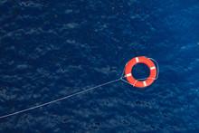 Lifebuoy In A Stormy Blue Sea,...