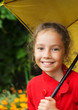 Little cute girl holding an umbrella