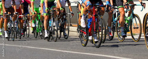 Foto op Plexiglas Fietsen legs of cyclists who ride during the race