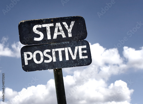 Fotografía Stay Positive sign with clouds and sky background