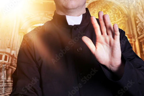 The priest at the church with raised hand Fototapeta