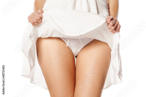 woman lifted her white dress and shows her white panties