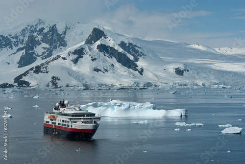 Tourist boat on a summer day in the strait near the Antarctic Pe