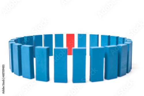 Photo  Circle of blue blocks with single red one