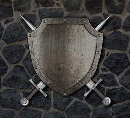 Fototapeta Struktura ściany Medieval shield and crossed swords on stone wall