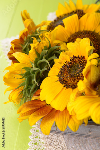 Fototapety, obrazy: Beautiful sunflowers in pitcher on napkin on table close up