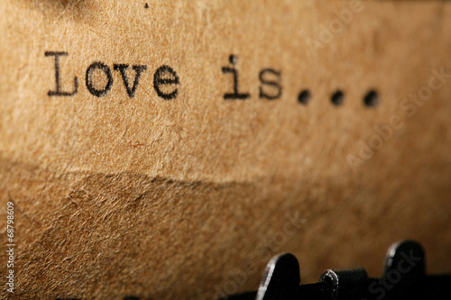 love is, the inscription on a typewriter