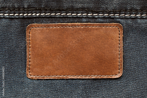 Fotobehang Stof Leather tag on jeans background