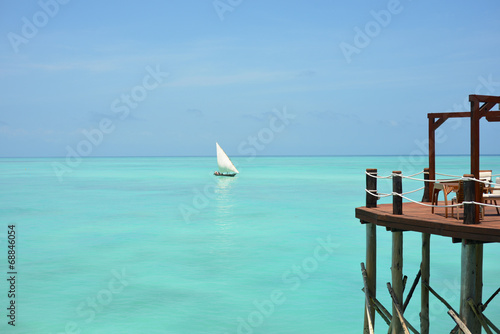 Poster Zanzibar Wooden Jetty on Seaview background with Dhow boat