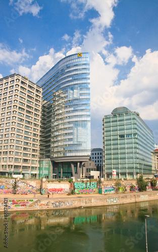 Fototapeten New York High-rise buildings, the Danube Canal. Vienna. Austria