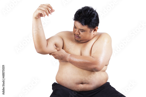 Fotografia, Obraz  Fat man holding his flabby biceps 1