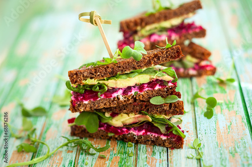 Staande foto Snack beet,avocado and arugula sandwich