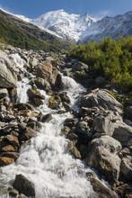 Stream From Melting Glacier In Graian Alps