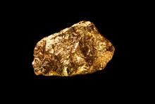 Gold Nugget On Black Background.