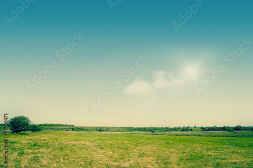 Foto op Canvas Pistache Green fields on a countryside landscape